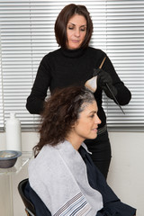 Hair Colouring in process - Woman at a hairdresser salon