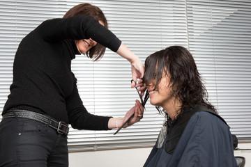 Woman cutting clients hair