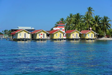 Tropical cabins over water of the Caribbean sea