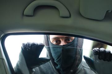 Car thief checking the car