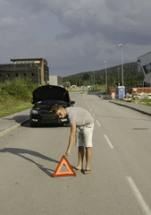 Setting up the warning triangle becouse of broken car