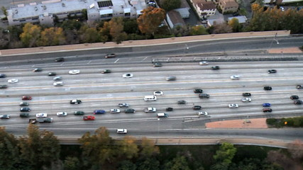 Speed Up Aerial View of Los Angeles Freeway / Highway / Suburbs