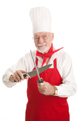 Mature Chef Sharpens Knife