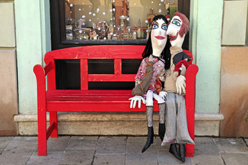 handmade lover dolls on red bench, Bratislava