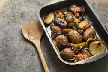 tray baked potatoes, and vegetables