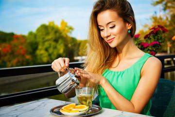 Young Woman Making Green Tea Outdoors