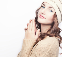 Beautifull young girl with blue eyes in winter wool hat and swea