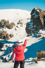 Woman in snowy mountains showing the path