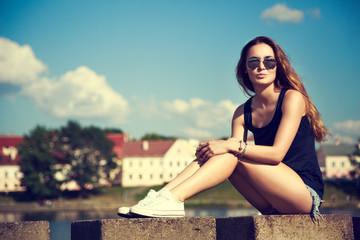 Trendy Hipster Girl Relaxing in the Park
