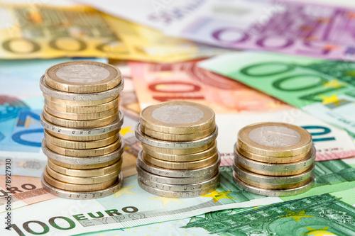 Leinwanddruck Bild Euroscheine und Euromünzen