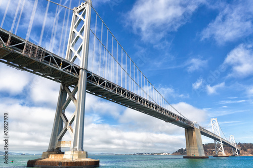 San Francisco Oakland Bay Bridge on a sunny day with clouds - 78927970