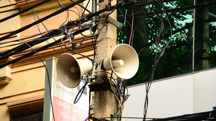Zoom Out of Propaganda Loudspeaker on Telephone Pole - Ho Chi Minh City