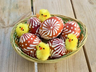 Rustic easter eggs in shallow basket