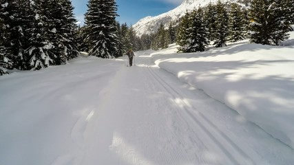 Snow walking, a woman on the winter hike