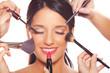 Leinwandbild Motiv Young woman getting professional beauty and makeup treatment