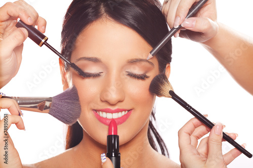 Young woman getting professional beauty and makeup treatment - 78930551