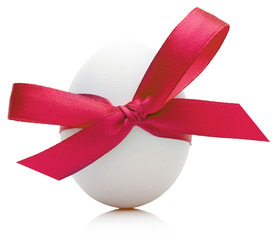Easter egg with festive red bow isolated on white background