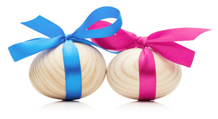 wooden Easter eggs with bows isolated on white background