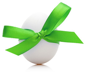 Easter egg with festive green bow isolated on white background