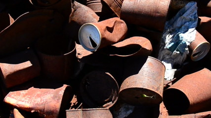 Pan of Rusting Tin Cans in a Mojave Desert