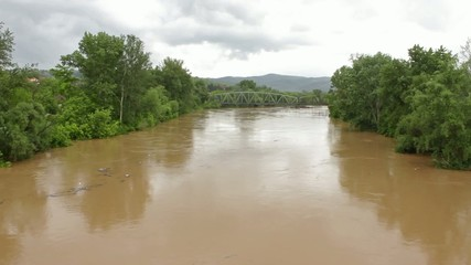 Waterway,river flow,flood after heavy rainfall,waste float