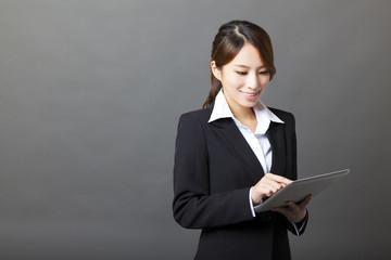 beautiful asian businesswoman using tablet pc