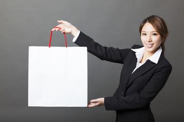 beautiful  business woman showing white shopping bag