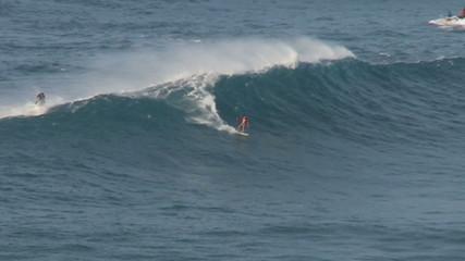 Big Wave Surfers at Jaws, Maui Hawaii - Slow Motion Clip 2 of 5