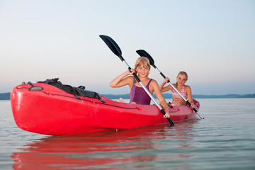 Girls with red kayak
