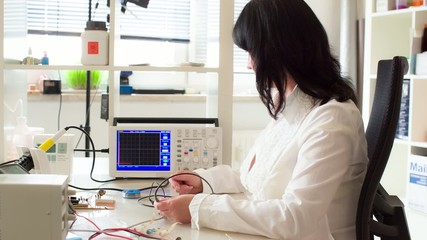 woman in the electronics lab