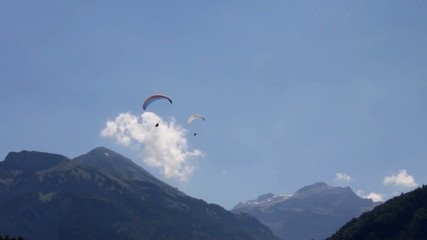 Paragliding on Swiss Alps background