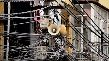 Zoom Out of Propaganda Loudspeaker on Telephone Pole - Ho Chi Minh City