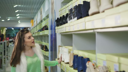 Woman chooses shoes store