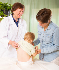 friendly pediatrician doctor examining baby