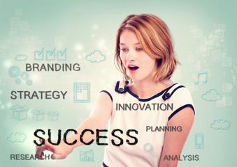 Young woman pointing at success concept
