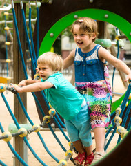 Little sisters at playground in park