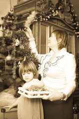 photo of grandmother and child preparing for  Christmas