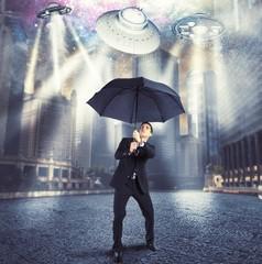 Businessman against alien attack