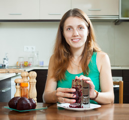 Casual  woman grating boiled beets