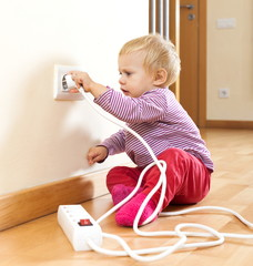 Toddler playing with  electric equipment
