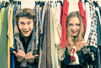 Young hipster couple in love - Fun at clothing market