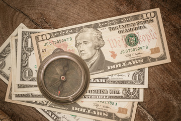 Compass on dollar banknote.