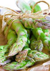 Fresh asparagus spears tied in a bundle - closeup