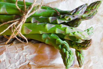 Fresh asparagus spears tied with string - closeup