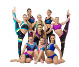 Group of pretty female gymnasts, isolated on white