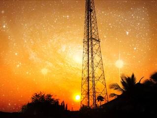 reception antenna with  orange sky and galaxy
