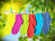 colorful socks hanging from a rope - 78944141