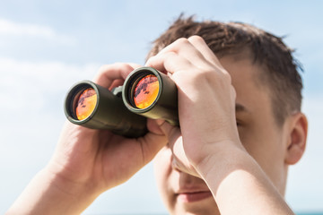 man is looking to the binocular