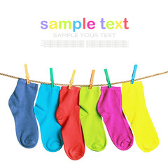 colorful socks hanging on a rope isolated