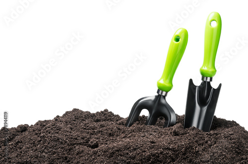 garden tools in soil isolated on white - 78944119